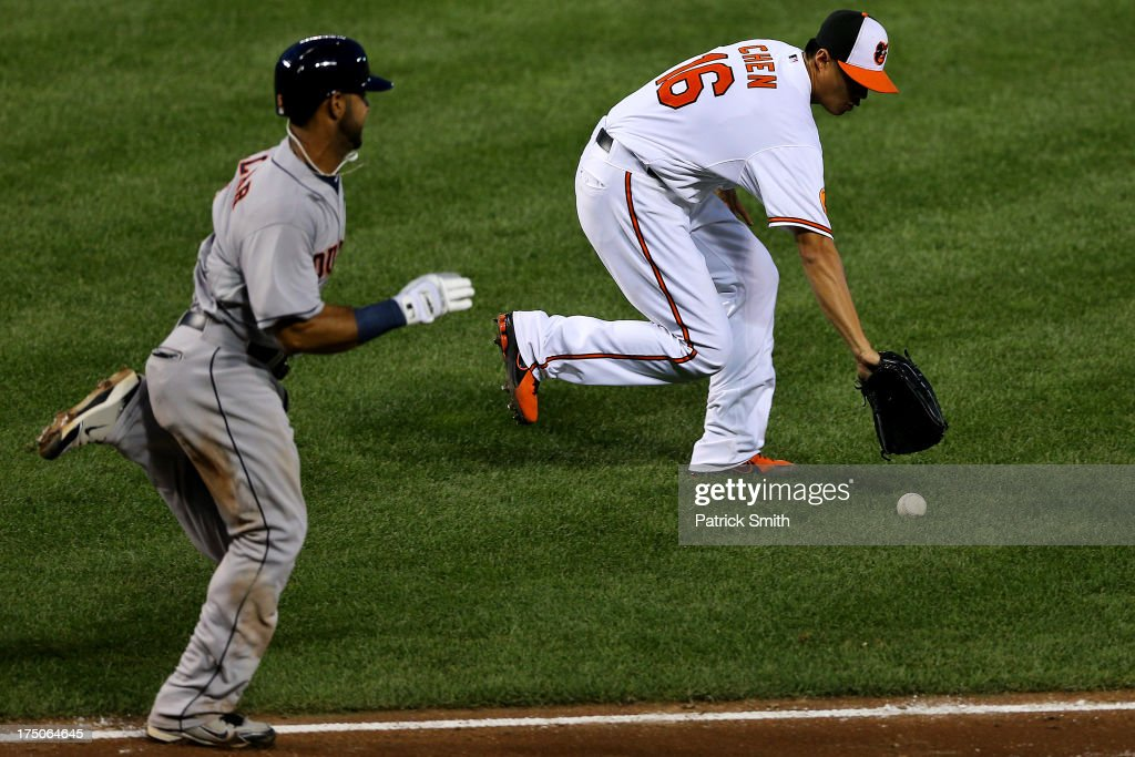 Pitcher <a gi-track='captionPersonalityLinkClicked' href=/galleries/search?phrase=Wei-Yin+Chen&family=editorial&specificpeople=8958243 ng-click='$event.stopPropagation()'>Wei-Yin Chen</a> #16 of the Baltimore Orioles scoops up a hit by Jonathan Villar #6 of the Houston Astros before throwing him out in the fifth inning at Oriole Park at Camden Yards on July 30, 2013 in Baltimore, Maryland. The Baltimore Orioles won, 4-3.
