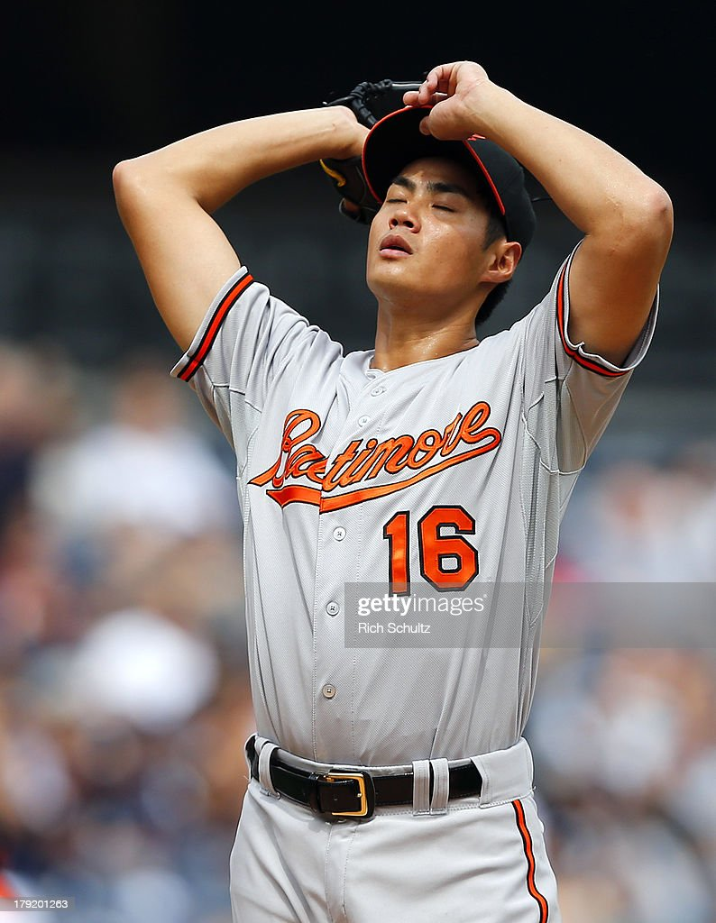 Pitcher <a gi-track='captionPersonalityLinkClicked' href=/galleries/search?phrase=Wei-Yin+Chen&family=editorial&specificpeople=8958243 ng-click='$event.stopPropagation()'>Wei-Yin Chen</a> of the Baltimore Orioles takes a breath between pitches during the first inning against the New York Yankees in a MLB baseball game at Yankee Stadium on September 1, 2013 in the Bronx borough of New York City.