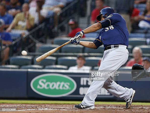Pitcher Wily Peralta of the Milwaukee Brewers hits a tworun single in the fourth inning during the game against the Atlanta Braves at Turner Field on...