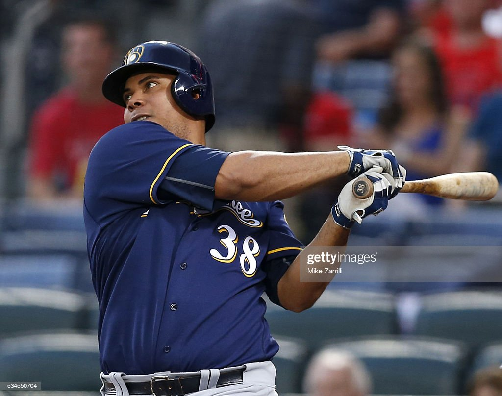 Pitcher <a gi-track='captionPersonalityLinkClicked' href=/galleries/search?phrase=Wily+Peralta&family=editorial&specificpeople=7505871 ng-click='$event.stopPropagation()'>Wily Peralta</a> #38 of the Milwaukee Brewers hits a two-run single in the fourth inning during the game against the Atlanta Braves at Turner Field on May 26, 2016 in Atlanta, Georgia.