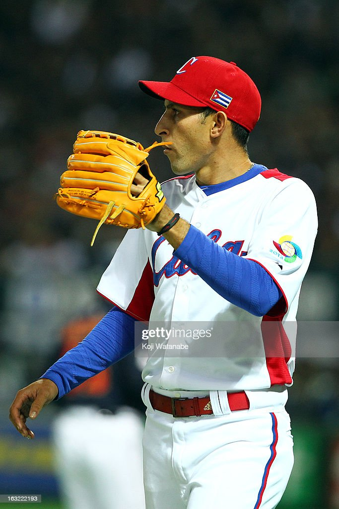 Pitcher Yander Guevara #26 of Cuba looks on during the World Baseball Classic First Round Group A game between Japan and Cuba at Fukuoka Yahoo! Japan Dome on March 6, 2013 in Fukuoka, Japan.