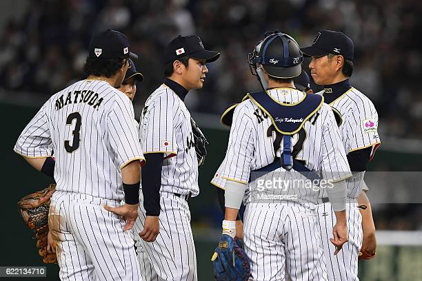 Pitcher Yasuaki Yamasaki of Japan is taken out from the game by Head coach Hiroki Kokubo during the international friendly match between Japan and...