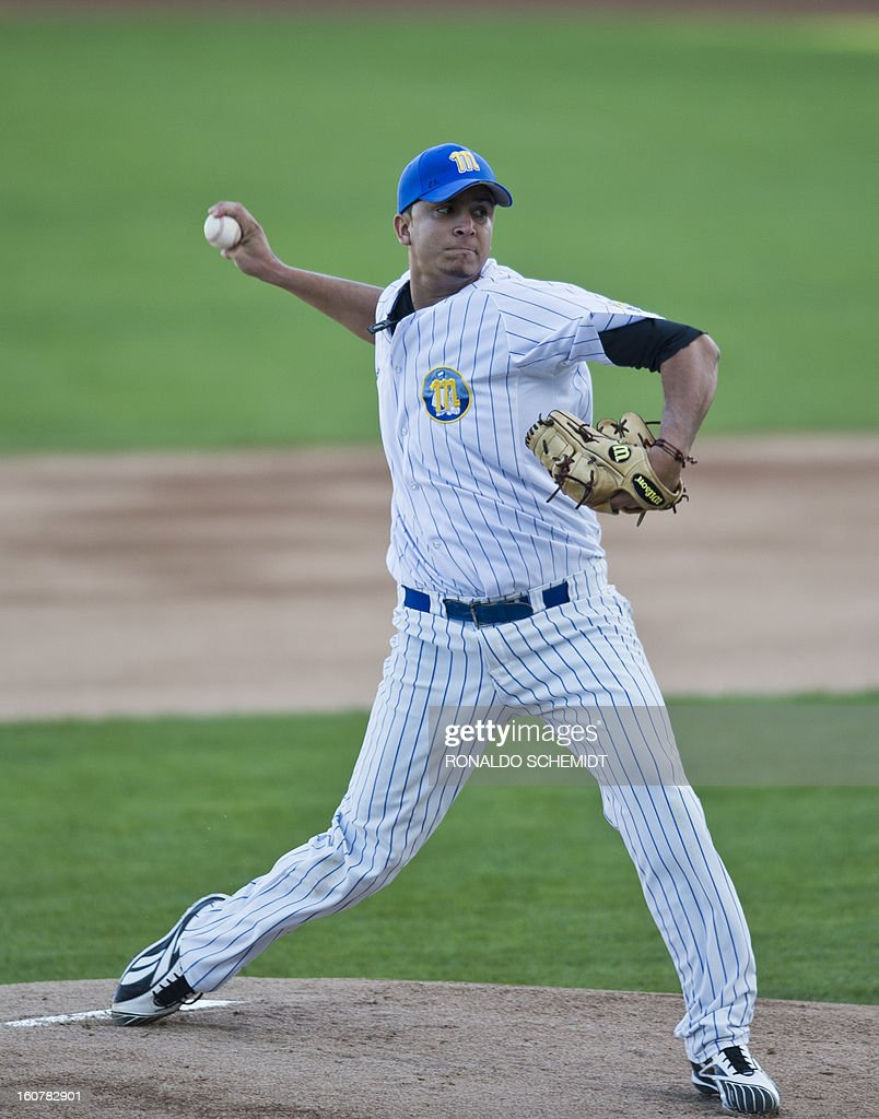 Pitcher Yeiper Castillo of Magallanes of Venezuela pitches against Criollos de Caguas of Puerto Rico, during the 2013 Caribbean baseball series, on February 5, 2013, in Hermosillo, Sonora State, in the northern of Mexico. AFP PHOTO/Ronaldo Schemidt