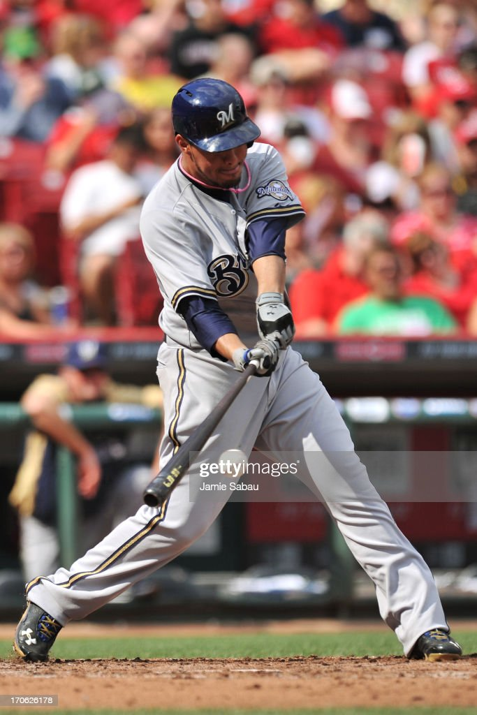 Pitcher Yovani Gallard #49 of the Milwaukee Brewers connects for a single in the third inning against the Cincinnati Reds at Great American Ball Park on June 15, 2013 in Cincinnati, Ohio.