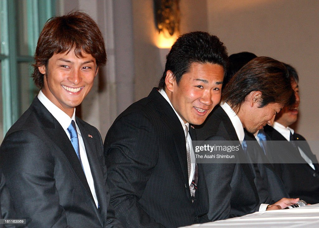 Pitcher <a gi-track='captionPersonalityLinkClicked' href=/galleries/search?phrase=Yu+Darvish&family=editorial&specificpeople=4018539 ng-click='$event.stopPropagation()'>Yu Darvish</a> (1st L) and <a gi-track='captionPersonalityLinkClicked' href=/galleries/search?phrase=Masahiro+Tanaka&family=editorial&specificpeople=5492836 ng-click='$event.stopPropagation()'>Masahiro Tanaka</a> (2nd L) of Japan smiles during a press conference held a day after winning the World Baseball Classic on March 24, 2009 in Los Angeles, California.