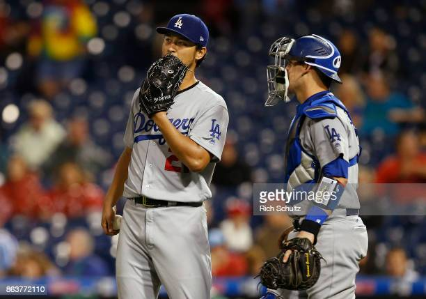Pitcher Yu Darvish of the Los Angeles Dodgers talks with catcher Yasmani Grandal during the sixth inning of a game against the Philadelphia Phillies...