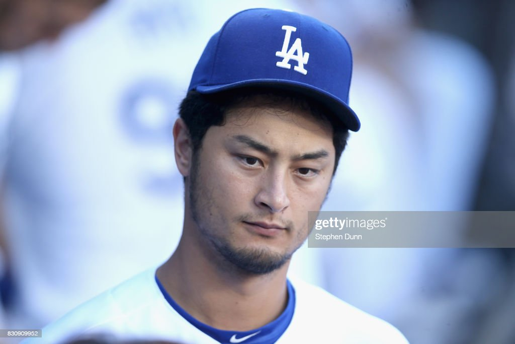 Pitcher Yu Darvish #21 of the Los Angeles Dodgers walks in the dugout before the game against the San Diego Padres at Dodger Stadium on August 12, 2017 in Los Angeles, California.