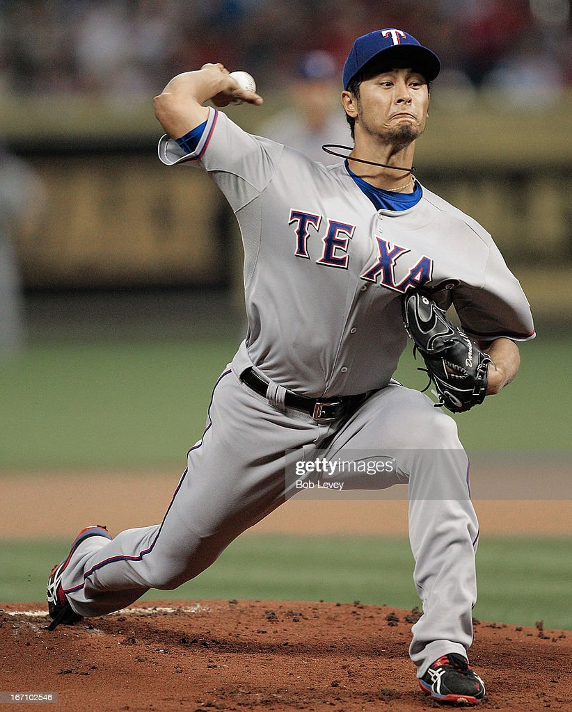 Pitcher Yu Darvish #11 of the Texas Rangers pitches against the Houston Astros at Minute Maid Park on April 2, 2013 in Houston, Texas.