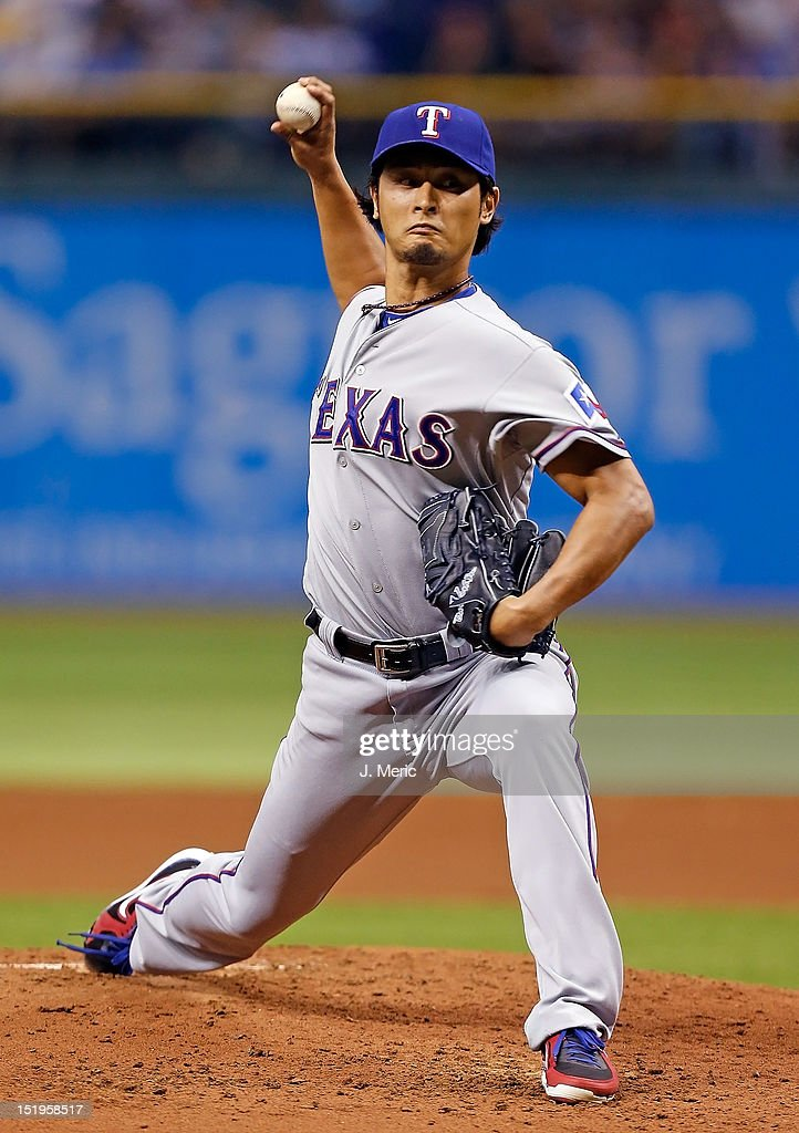 Pitcher <a gi-track='captionPersonalityLinkClicked' href=/galleries/search?phrase=Yu+Darvish&family=editorial&specificpeople=4018539 ng-click='$event.stopPropagation()'>Yu Darvish</a> #11 of the Texas Rangers pitches against the Tampa Bay Rays during the game at Tropicana Field on September 8, 2012 in St. Petersburg, Florida.