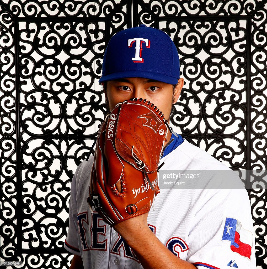 Pitcher Yu Darvish #11 of the Texas Rangers poses during a spring training photo shoot on February 28, 2016 in Surprise, Arizona.