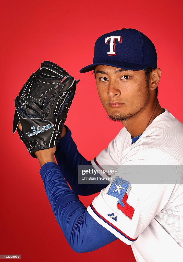 Pitcher Yu Darvish #11 of the Texas Rangers poses for a portrait during spring training photo day at Surprise Stadium on February 20, 2013 in Surprise, Arizona.