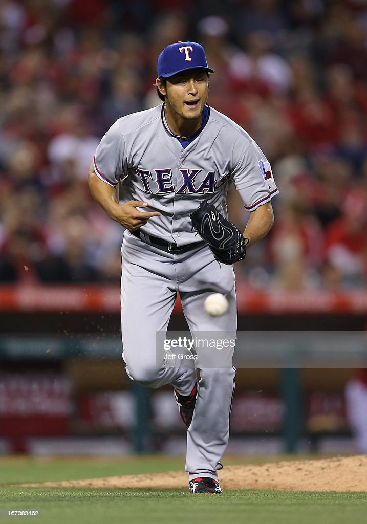 Pitcher <a gi-track='captionPersonalityLinkClicked' href=/galleries/search?phrase=Yu+Darvish&family=editorial&specificpeople=4018539 ng-click='$event.stopPropagation()'>Yu Darvish</a> #11 of the Texas Rangers runs towards first base to cover on a ball hit by Josh Hamilton (not pictured) of the Los Angeles Angels of Anaheim in the fourth inning at Angel Stadium of Anaheim on April 24, 2013 in Anaheim, California.