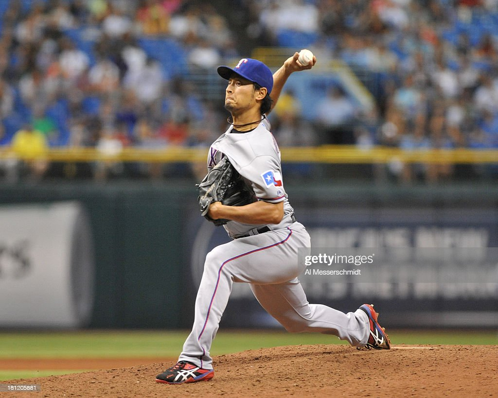 Pitcher <a gi-track='captionPersonalityLinkClicked' href=/galleries/search?phrase=Yu+Darvish&family=editorial&specificpeople=4018539 ng-click='$event.stopPropagation()'>Yu Darvish</a> #11 of the Texas Rangers starts against the Tampa Bay Rays September 19, 2013 at Tropicana Field in St. Petersburg, Florida. Darvish was the winnng pitcher and Texas won 8 - 2.
