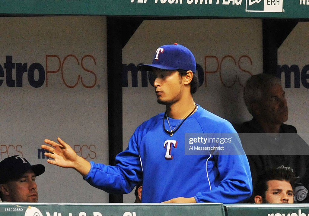 Pitcher <a gi-track='captionPersonalityLinkClicked' href=/galleries/search?phrase=Yu+Darvish&family=editorial&specificpeople=4018539 ng-click='$event.stopPropagation()'>Yu Darvish</a> #11 of the Texas Rangers watches play late in the game after starting against the Tampa Bay Rays September 19, 2013 at Tropicana Field in St. Petersburg, Florida. Darvish was the winning pitcher. Texas won 8 - 2.