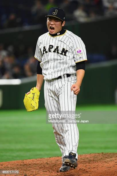 Pitcher Yuki Matsui of Japan walks to the dugout after the top of the seventh inning during the World Baseball Classic Pool E Game Four between Cuba...