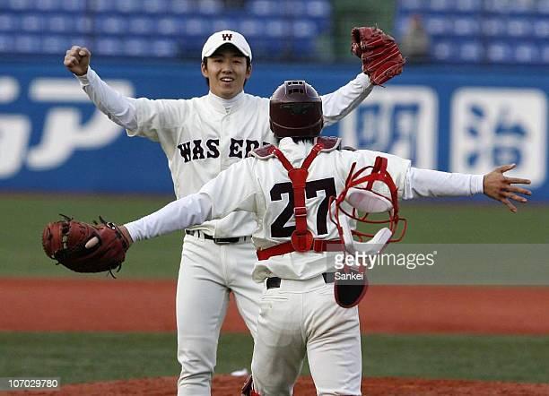 Pitcher Yuki Saito and catcher Daisuke Ichimaru celebrate winning the Meiji Jingu Baseball Tournament at Jingu Stadium on November 18 2010 in Tokyo...