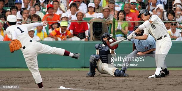 Pitcher Yuki Saito of Waseda Jitsugyo High School throws the last pitch to strike out pitcher Masahiro Tanaka of Komadai Tomakomai High School to win...
