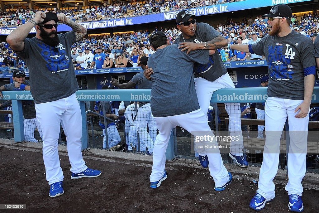 Pitchers Brian Wilson #00, Chris Withrow #44, Ronald Belisario #54 and <a gi-track='captionPersonalityLinkClicked' href=/galleries/search?phrase=J.P.+Howell&family=editorial&specificpeople=794363 ng-click='$event.stopPropagation()'>J.P. Howell</a> #56 of the Los Angeles Dodgers joke around after the game against the Colorado Rockies at Dodger Stadium on September 29, 2013 in Los Angeles, California.