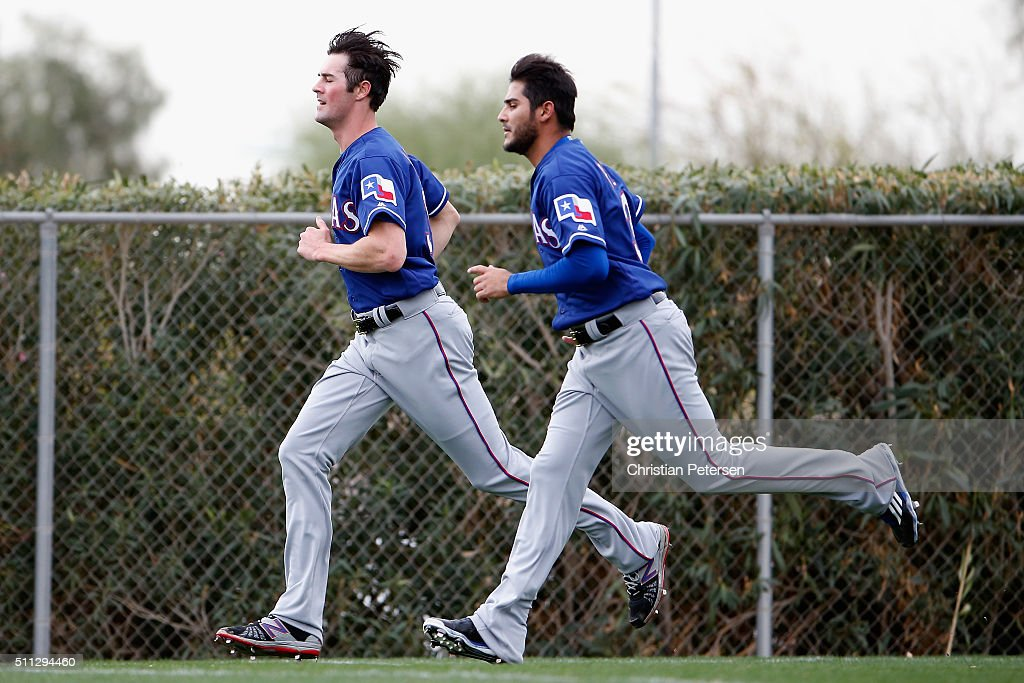 Pitchers <a gi-track='captionPersonalityLinkClicked' href=/galleries/search?phrase=Cole+Hamels&family=editorial&specificpeople=565675 ng-click='$event.stopPropagation()'>Cole Hamels</a> #35 and Martin Perez #33 of the Texas Rangers participate in a spring training workout at Surprise Stadium on February 19, 2016 in Surprise, Arizona.