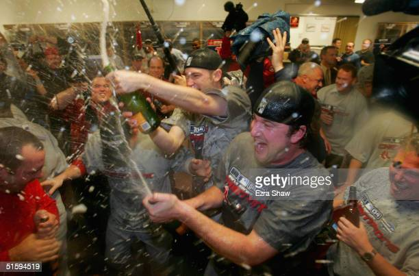Pitchers Derek Lowe and Bronson Arroyo of the Boston Red Sox celebrate in the locker room after defeating the St Louis Cardinals 30 to win game four...