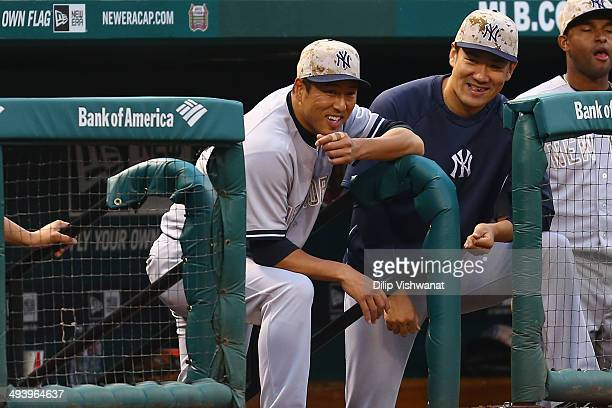 Pitchers Hiroki Kuroda and Masahiro Tanaka of the New York Yankees watch the game against the St Louis Cardinals in the twelfth inning at Busch...