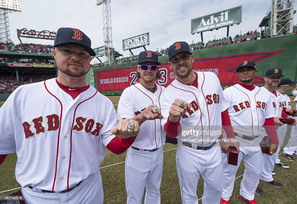 Pitchers <a gi-track='captionPersonalityLinkClicked' href=/galleries/search?phrase=Jon+Lester&family=editorial&specificpeople=832746 ng-click='$event.stopPropagation()'>Jon Lester</a> #31, <a gi-track='captionPersonalityLinkClicked' href=/galleries/search?phrase=Clay+Buchholz&family=editorial&specificpeople=4424901 ng-click='$event.stopPropagation()'>Clay Buchholz</a> #11 and <a gi-track='captionPersonalityLinkClicked' href=/galleries/search?phrase=John+Lackey&family=editorial&specificpeople=171533 ng-click='$event.stopPropagation()'>John Lackey</a> #41 of the Boston Red Sox show off their 2013 championship rings during a ceremony honoring the 2013 World Series Champion Boston Red Sox before the start of a game against the Milwaukee Brewers at Fenway Park on April 4, 3014 in Boston, Masschusetts.