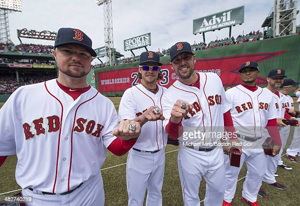 Pitchers Jon Lester Clay Buchholz and John Lackey of the Boston Red Sox show off their 2013 championship rings during a ceremony honoring the 2013...
