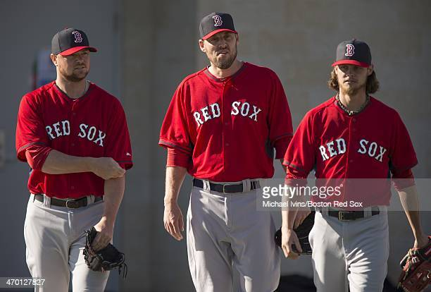 Pitchers Jon Lester John Lackey and Clay Buchholz of the Boston Red Sox take the field before the start of a Spring Training workout at Fenway South...
