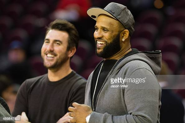 MLB pitchers Justin Verlander of the Detroit Tigers and CC Sabathia of the New York Yankees joke with friends prior to the game between the Cleveland...