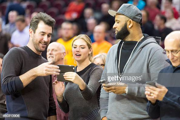 MLB pitchers Justin Verlander of the Detroit Tigers CC Sabathia of the New York Yankees and model Kate Upton on the court prior to the game between...