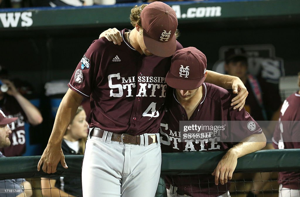 Pitchers Kendall Graveman #49 (L) and Ross Mitchell #48 of the Mississippi State Bulldogs embrace after losing to the UCLA Bruins during game two of the College World Series Finals on June 25, 2013 at TD Ameritrade Park in Omaha, Nebraska. UCLA won 8-0 to take the series two games to none and win the College World Series Championship.