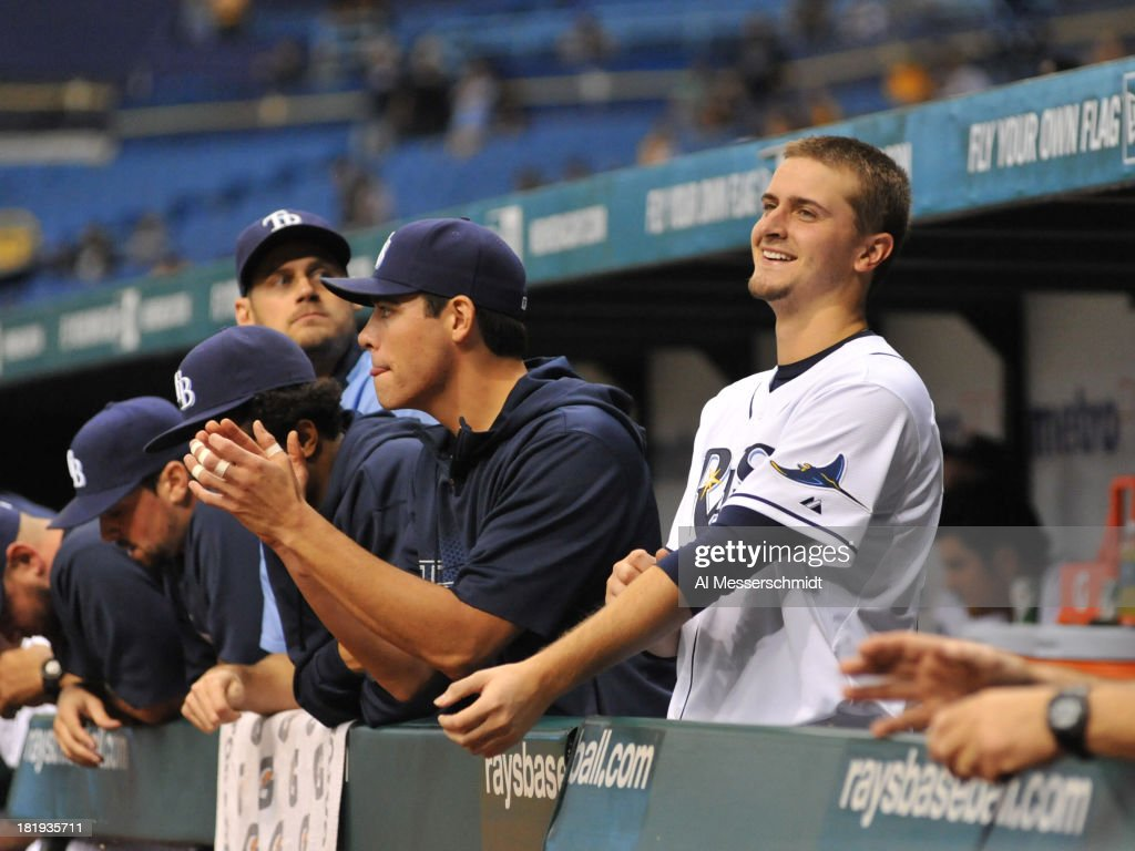 Pitchers Matt Moore #55 and Jake Ordoizzi #23 of the Tampa Bay Rays cheer play against the Baltimore Orioles September 20, 2013 at Tropicana Field in St. Petersburg, Florida. The Rays won 5 - 4 in 18 innings.