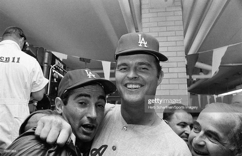 Pitchers Sandy Koufax #32 and Don Drysdale #53 of the Los Angeles Dodger celebrate after defeating the Minnesota Twins in the 1965 World Series in Metropolitan Stadium on October 14, l965 in Minneapolis, Minnesota.