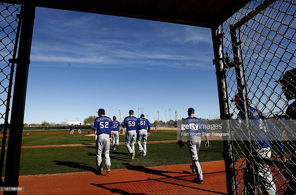 Pitchers take the mound for a drill during Texas Rangers spring training, Friday, February 15, 2013, in Surprise, Arizona.