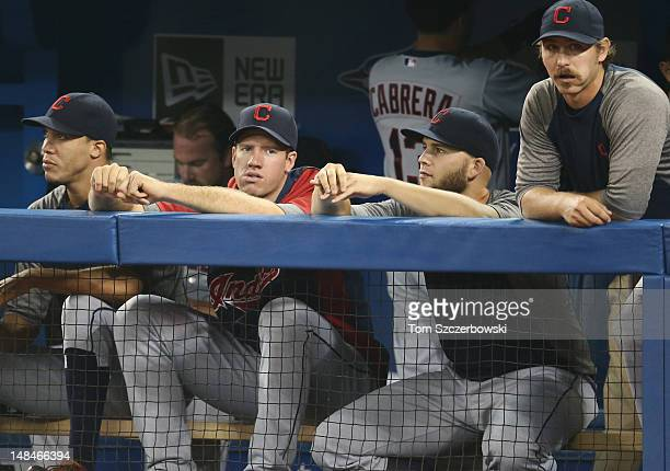 Pitchers Ubaldo Jimenez of the Cleveland Indians sits in the dugout next to Derek Lowe Zach McAllister Justin Masterson 63 and Josh Tomlin during MLB...