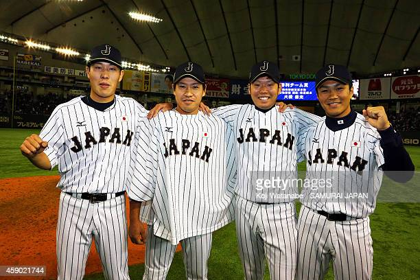 Pitchers Yuji Nishino Kazuhisa Makita Yuki Nishi and Takahiro Norimoto of Samurai Japan pose for photographs after winning the game three of Samurai...