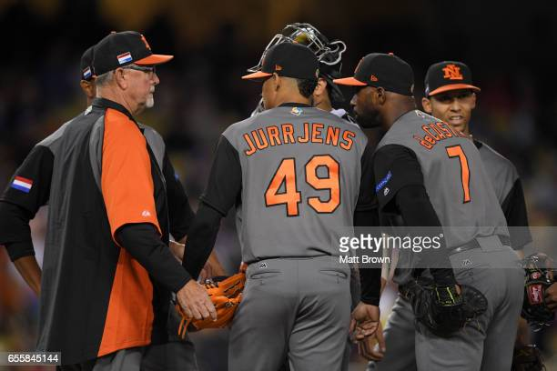 Pitching coach Bert Blyleven visits Jair Jurrjens of Team Netherlands on the mound in the fourth inning of Game 1 of the Championship Round of the...
