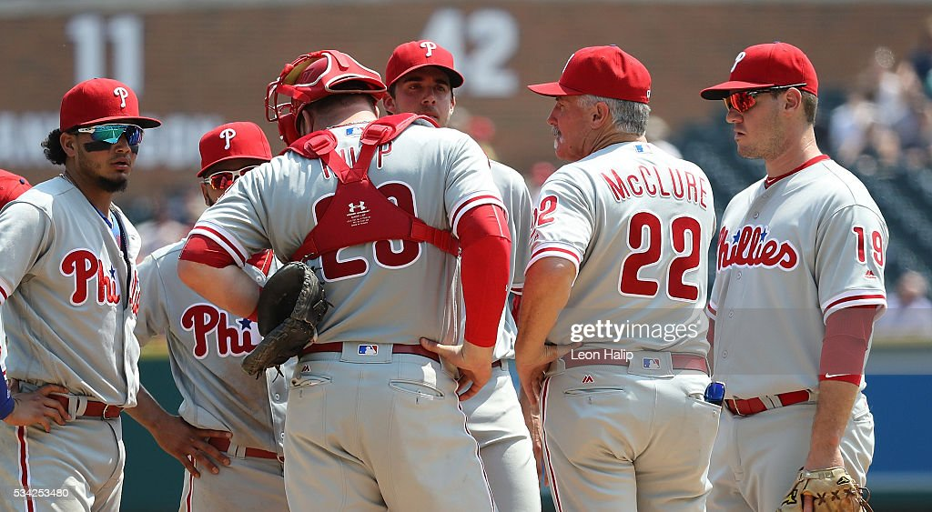 Pitching coach Bob McClure #22 of the Philadelphia Phillies talks with starting pitcher <a gi-track='captionPersonalityLinkClicked' href=/galleries/search?phrase=Aaron+Nola&family=editorial&specificpeople=10891411 ng-click='$event.stopPropagation()'>Aaron Nola</a> #27 during the fifth inning of the inter-league game against the Detroit Tigers on May 25, 2016 at Comerica Park in Detroit, Michigan.