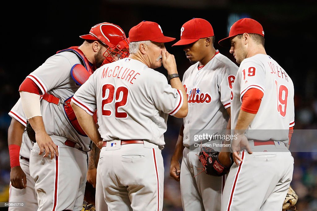 Pitching coach Bob McClure #22 of the Philadelphia Phillies talks with relief pitcher Edubray Ramos #61 during the seventh inning of the MLB game against the Arizona Diamondbacks at Chase Field on June 29, 2016 in Phoenix, Arizona.