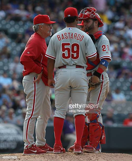 Pitching coach Bob McClure of the Philadelphia Phillies visits the mound to talk to relief pitcher Antonio Bastardo of the Philadelphia Phillies and...