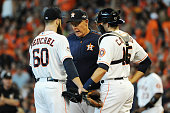 Pitching coach Brent Strom of the Houston Astros visits Dallas Keuchel of the Houston Astros on the pitcher's mound in the fourth inning against the...