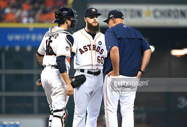 Pitching coach Brent Strom of the Houston Astros visits Dallas Kuechel on the mound during Game 3 of the ALDS against the Kansas City Royals at...