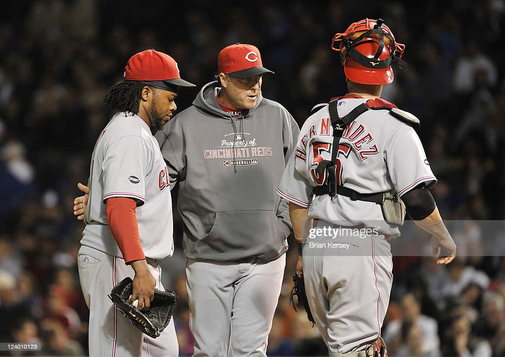 Pitching coach Bryan Price (C) of the Cincinnati Reds and catcher <a gi-track='captionPersonalityLinkClicked' href=/galleries/search?phrase=Ramon+Hernandez&family=editorial&specificpeople=179461 ng-click='$event.stopPropagation()'>Ramon Hernandez</a> #55 talk with starting pitcher <a gi-track='captionPersonalityLinkClicked' href=/galleries/search?phrase=Johnny+Cueto&family=editorial&specificpeople=4921735 ng-click='$event.stopPropagation()'>Johnny Cueto</a> #47 during the sixth inning at Wrigley Field on September 7, 2011 in Chicago, Illinois. The Cubs defeated the Reds 6-3.