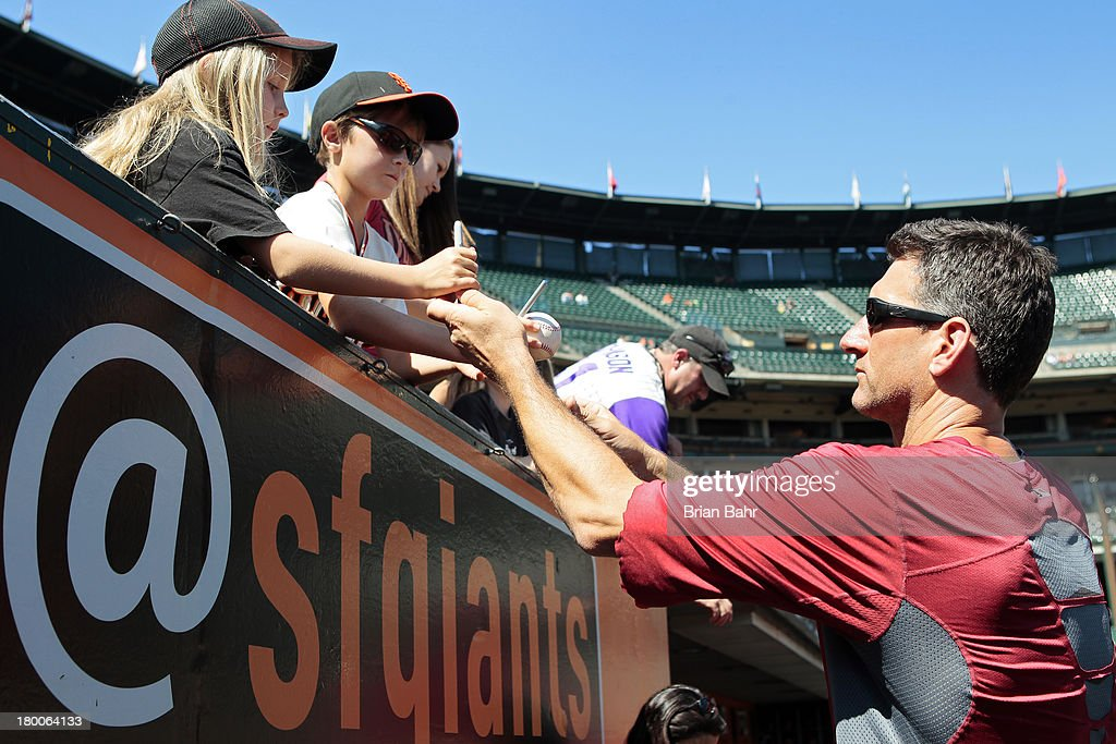Pitching coach <a gi-track='captionPersonalityLinkClicked' href=/galleries/search?phrase=Charles+Nagy&family=editorial&specificpeople=228746 ng-click='$event.stopPropagation()'>Charles Nagy</a> #50 of the Arizona Diamondbacks signs autographs before a game against the San Francisco Giants at AT&T Park on September 8, 2013 in San Francisco, California.