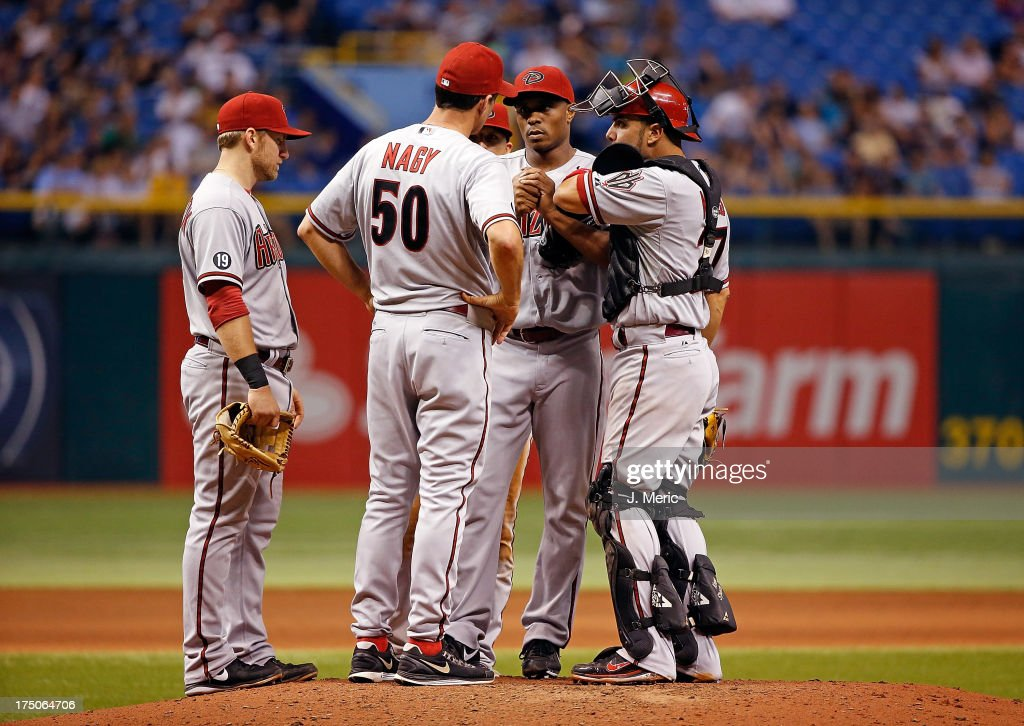 Pitching coach <a gi-track='captionPersonalityLinkClicked' href=/galleries/search?phrase=Charles+Nagy&family=editorial&specificpeople=228746 ng-click='$event.stopPropagation()'>Charles Nagy</a> #50 of the Arizona Diamondbacks talks with pitcher Tony Sipp #49 during the game against the Tampa Bay Rays at Tropicana Field on July 30, 2013 in St. Petersburg, Florida.