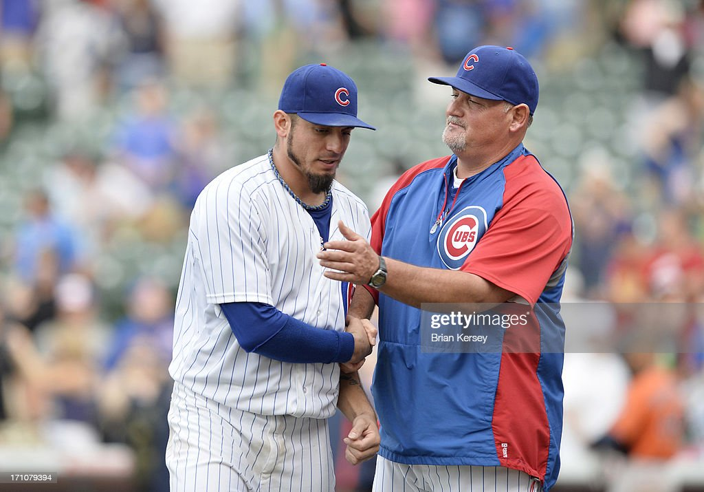 Pitching coach Chris Bosio #25 of the Chicago Cubs (R) congratulates starting pitcher Matt Garza #22 after the Cubs defeated the Houston Astros 3-1 at Wrigley Field on June 21, 2013 in Chicago, Illinois.