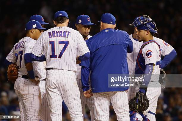 Pitching coach Chris Bosio of the Chicago Cubs meets with Pedro Strop in the seventh inning against the Los Angeles Dodgers during game three of the...