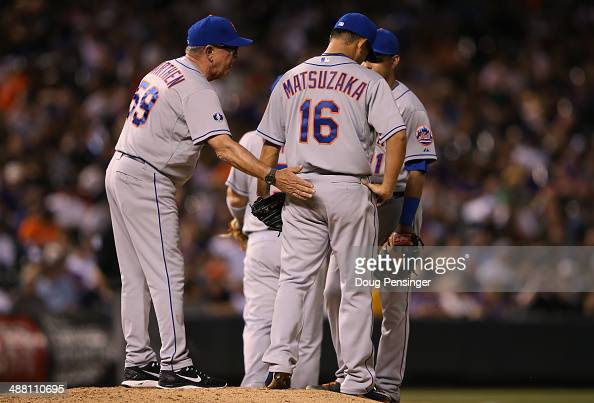 Pitching coach Dan Warthen of the New York Mets visits the mound to check on relief pitcher Daisuke Matsuzaka of the New York Mets as he works...