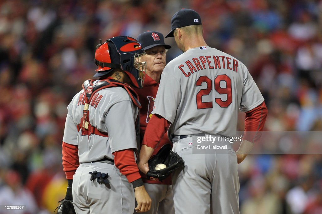 Pitching coach <a gi-track='captionPersonalityLinkClicked' href=/galleries/search?phrase=Dave+Duncan&family=editorial&specificpeople=548039 ng-click='$event.stopPropagation()'>Dave Duncan</a> #18 of the St. Louis Cardinals visits with <a gi-track='captionPersonalityLinkClicked' href=/galleries/search?phrase=Chris+Carpenter+-+Baseball+Player&family=editorial&specificpeople=208139 ng-click='$event.stopPropagation()'>Chris Carpenter</a> #29 and <a gi-track='captionPersonalityLinkClicked' href=/galleries/search?phrase=Yadier+Molina&family=editorial&specificpeople=172002 ng-click='$event.stopPropagation()'>Yadier Molina</a> #4 in the first inning against the Philadelphia Phillies during Game Two of the National League Division Series at Citizens Bank Park on October 2, 2011 in Philadelphia, Pennsylvania.