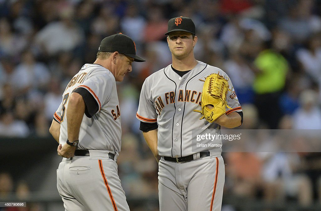 Pitching coach Dave Righetti #33 of the San Francisco Giants (L) talks with starting pitcher Matt Cain #18 during the fourth inning against the Chicago White Sox at U.S. Cellular Field on June 17, 2014 in Chicago, Illinois. The White Sox defeated the Giants 8-2.